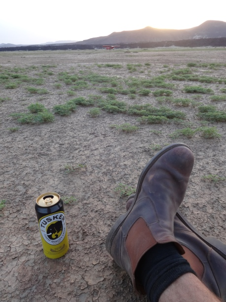 cold beer on the dried mud flats of the Suguta